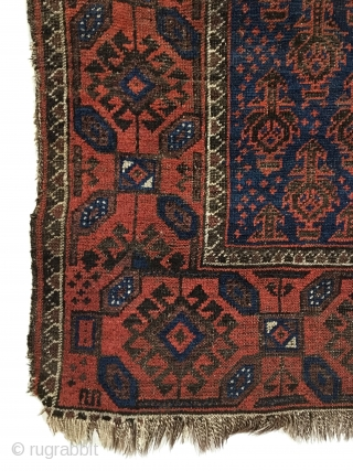 Antique Baluch Rug. North East Persia. Mid 19th Century. Deep blue field covered with Dokhtar-I-Ghazi bird trees. A main border of intermittent octagons enclosing bird head diamonds, associated with earlier rugs. Great  ...