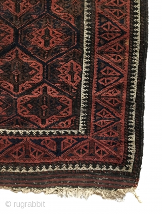 Antique Baluch Rug. Timuri, Sangtshuli. 3rd Quarter 19th Century. This is an early collectors rug. The main border consists of alternating triangles of tulip like three stemmed plants. Bright white medakhyl (medical)  ...