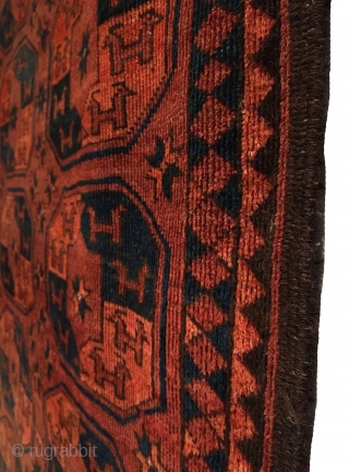 Antique Ersari small main carpet. Early 19th Century. This carpet features a 3x9 gol format 'tauk-noska' horned animal heads look in opposing directions. Secondary guls are in the form of star trees  ...