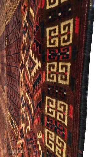 Antique Yomud Ensi. Subtle purple-brown field. Folded kilim top with remnants of woven hanging chords. Full Pile.  Very good condition besides one tiny hole. 4'2 x 4'11. Carefully hand washed.