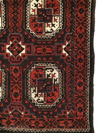 Salar Khani Baluch Rug.  North-east Persia.  Circa 1880. Turkmen gols float on a madder and slightly corroded embossed brown field.  Mint condition.  5 colors.  67 x 35.  ...