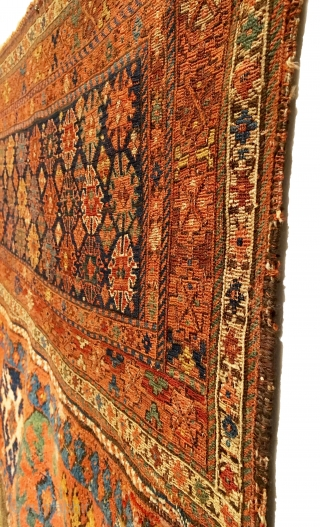Antique Bakhtiari Large Saddlebag. 2nd Half 19th Century. Bag front. Mother goddess like figures nest between truly tribal, archaic gols. Rare weaving in both soumak and piled sections. Full pile lower panel.  ...