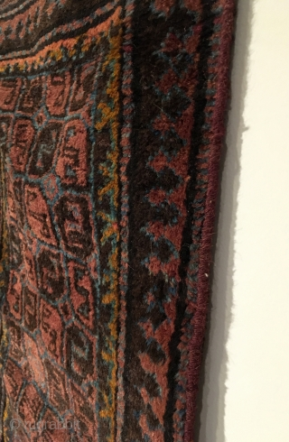 Small Afghan Baluch Rug.  Circa Antique.  5x2 gul patterned field.  Full lustrous pile.  One small hole.  5 colors.  40.5 x 22.  Clean and hand washed.
