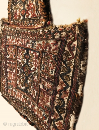 Antique Bakhtiari Salt Bag.  Circa 1900.  Ivory field.  Opposing bird head border encloses paired bird main border.  Central bird tree totem.  Fine weave.  All original sides.   ...
