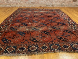 Antique Ersari Nomadic Main Carpet. Mid 19th Century. 15 large octagonal guls in blue and orange float on glowing madder red field. Star tipped diamond gols within main gul are also woven  ...