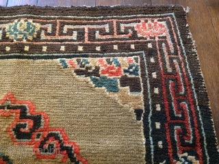 "seating rug, central tibet, circa 1900, 58 x 67 cm, 1'11"" x 2'3"". Some little knots in one corner are new, otherwise no restoration."
