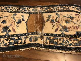 "lovely white ground ningxia saddle rug, west china, 19th century, 130 x 58 cm, 4'3"" x 1'11"", upper ends open, one half partly worn, no restoration"