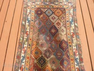Unusual antique Kurdish runner with various condition problems. About 40 inches x 14feet.