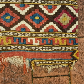 Antique 19c Manastir kilim yastik, roughly 100cm x 60cm.  A good one.   Excellent colours but some damage as evidenced. These pieces are often smashed so this one is in fairly good condition comparatively  ...