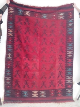 Antique Balkan kilim with interesting human figure motifs.