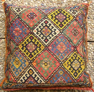 """# 035 Rare Kordi chanteh, filled with sheep wool to form a pillow, 40/39 cm, Khorasan, Northeast Persia, ca. 1925, in good condition with natural dyes and one early """"Mauvein"""", cf. Stanzer,  ..."""