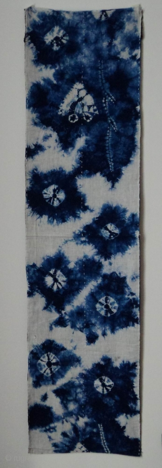 "Indigo Kumo Shibori 'zoikin', Japan, Taisho (c.1920), 134x33cm. The common English translation of the Japanese word shibori is ""tie-dye"". However, a more accurate translation is ""shaped-resist dyeing,"" which describes the inherent patterning  ..."