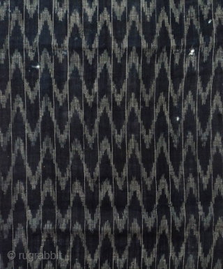 Kasuri cotton 'flaming' panel, Japan, Meiji (circa 1880), cm 99x33. 'kasuri' is the Japanese term for what is commonly knows as ikat weaving. The kasuri process involves yarns being tied before they  ...