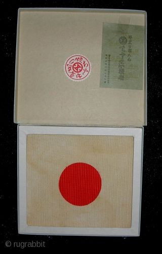 'Hinomaru' Fukusa, Japan, early Showa (circa 1930's), 17x18 cm. A fukusa is a Japanese ceremonial square of cloth used to cover a gift during its formal presentation. Since ceremonial procedures permeated all  ...