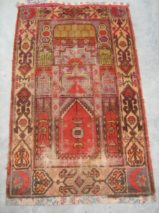 Antique Khotan prayer rug early 20th century . four crecents at the corners. mosque desing in the centre. worn at some places. size 2' x4'.