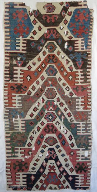 "Central Anatolian kilim fragment mounted on Linen Size: 53"" X 24"" -- 134 cm X 60 cm"