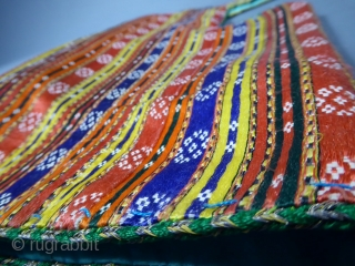 Circa 1900/1950 Tunisia Beautiful wedding ceremony jacket from the Hammamet or Rafraf region in Tunisia. Back is in satin silk and multicolored cotton (violet, orange and red with thin stripes). Dickey with braids of  ...