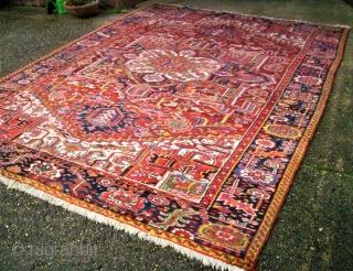 Old persian Heriz. Size: 243 x 353 cm. Good conditon.