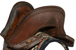 Tibetan wooden saddle with shagreen (the skin from a shark or stingray) decorating the front and back 'faces' and lower flat surfaces at either end. The rich grained wood has a beautiful  ...