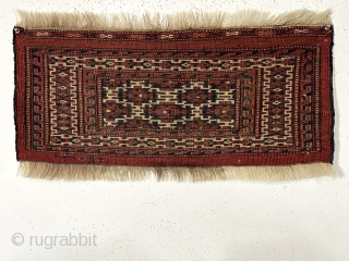 Antique little turkman torba, probably yomud, with interesting aksu design and excellent overall condition. All natural colors with nice light blues and apricot highlights. Good tight weave with medium length pile. No  ...