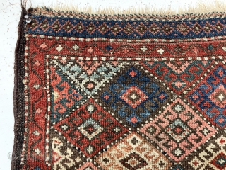 """Antique jaf Kurd diamond bagface. Interesting example with the less common """"dotted"""" lattice. Overall low pile with scattered wear as shown. All good natural colors including several reds, blues, a nice camel  ..."""