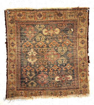 Antique little bagface, probably northwest Persian Kurdish, with an interesting, somewhat unusual design. Pretty yellow border and deep blue ground. I see a nice old purple as well. Odd strong orange color  ...