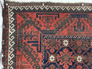 """Antique small Baluch rug with a """"snowflake"""" type design and turkman """"boat"""" border. Very good natural color featuring a rich ember red ample white highlights and a deep blue ground. Overall decent  ..."""