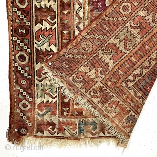 """Antique little Turkish village prayer rug, possibly bergama, with some interesting design features and older colors but very rough condition. Appears both madder and cochineal reds used. Attractive ivory """"leaf"""" border. Overall  ..."""