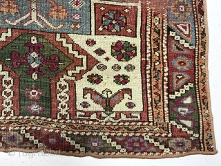 Antique little west Anatolian rug with an interesting design and older colors but with wear and in rough condition. A tribal variation of a double re entry field surrounded by a classic  ...