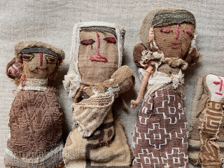 """Charming small family of older South American dolls. Constructed using remnant very early fabric. Tallest about 10""""."""