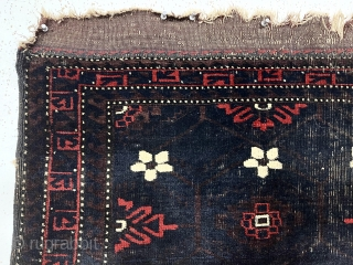 Antique Baluch weaving, either an unusually large bagface or an uncommon small mat. Spacious early drawing of classic Mina Hani design with a barely visible brown lattice on the deep blue ground.  ...