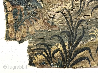 """Small authentic verdure tapestry fragment, in very rough condition, likely 18th c. or earlier. As found, small holes, tears and rough edges all around. Reasonably clean. Sewn to old backing. 33"""" x  ..."""