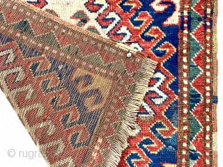 Antique bagface, possibly an uncommon Caucasian Kazak example. Interesting latch bold hooked design similar to what one might find on a Kazak rug. Fair pile with some wear as shown. All good  ...