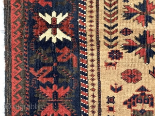 Antique Baluch camel ground prayer rug with spacious drawing and unusually saturated colors. As good an ember red as I have seen. Iconic tree of life flanked by narrow floral motifs and  ...