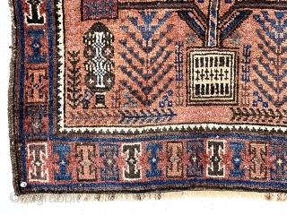 "Antique small Baluch rug with a version of this spacious ""tree in a vase"" design. The unusual aspect of this rug is the diminutive size, probably 1/2 - 2/3 the size of  ..."
