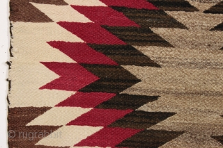 antique very small navajo rug or saddle blanket. As found this week, in very good condition, reasonably clean with no color run. Soft and supple. Interesting fancy selvage treatment. Pretty little jewel.  ...