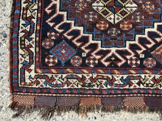 Antique pair of very pretty south Persian bagfaces assembled to make a small mat. Good overall pile with a nice range of natural colors. Ends have original closure tabs. Selvages a bit  ...