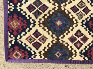 """Antique little Anatolian kelim fragment. Pretty little ivory ground remnant. Reasonably clean. Cloth edging all around. All natural colors. Mostly good condition, one corner a bit tattered. 19th c. 24"""" x 28"""""""