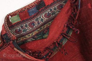 antique complete tribal bag, probably south persian afshar. As found, very very dirty with overall good thick even pile. Pretty greens. Original back, closure tabs and loops. Will need a good was  ...