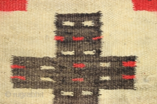 "Antique Navajo weaving with intriguing design. So called ""pound"" rug or blanket. Crude, thick weave. Natural wool colors and characteristic red. Dirty and with end damage as shown. Late 19th c. 4'2""  ..."
