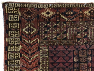 Antique tekke ensi. As found, very very dirty and with various holes and a corner rounding as shown. Mostly good pile with some light scattered wear. Colors appear natural with no color  ...
