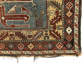 Antique small Caucasian rug in good condition with a dramatic design and attractive colors featuring a lovely yellow main border. The easily recognized karagashli type motifs and numerous animals float on a  ...