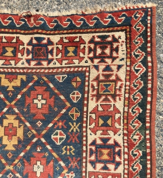 Antique small kazak rug with an uncommon all over design. Freely drawn with a fun candy cane lattice. As found, very very dirty but i can see under the grime the colors  ...