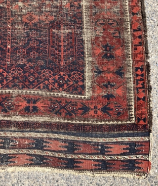 Early blue ground Baluch rug. A small timuri main carpet? Good variety of archaic field motifs and an elegant border. All natural colors. Overall thin with very low pile with areas of  ...