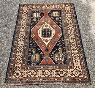 Antique Caucasian shirvan rug with a somewhat uncommon field paired with a nicely drawn Kufic border. Overall even low pile with some light scattered wear and oxidation. All natural colors including nice  ...