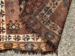 Antique Caucasian rug with dark goat hair warps, likely Zakatala. Bold large scale drawing. Interesting all natural color palette. Overall low pile. Selvages not original. End loss. Faded out small old patch  ...