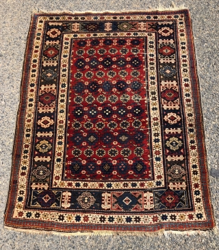 Antique small Caucasian shirvan rug with attractive drawing, good condition and first rate color. A chi chi variant allover field with colorful Kufic border. Overall mostly good even pile with a few  ...