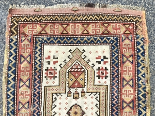 Antique Anatolian ivory ground prayer rug, likely Manastir origin. Lovely archaic drawing and characteristic use of lighter Manastir natural colors. Intact with remnant original selvages and kelim at top. Scattered small old  ...