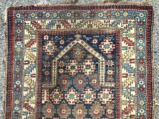 Antique Caucasian prayer rug with chi  chi type design. As found, very dirty. All good natural colors. Very low pile with wear as shown. Few small old crude repairs. Remnant original  ...