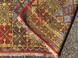 Antique Turkish village prayer rug. Simple, dramatic drawing. Good saturated natural colors including a rich tomato red, strong yellow, sky blues, lovely greens and a nice old aubergine. Overall low pile with  ...